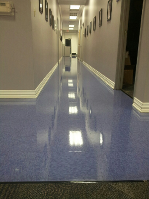 Valor Janitorial, strip and wax job of VCT tile flooring in an office building hallway