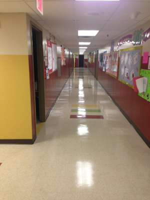 Valor Janitorial, strip and wax job of VCT tile flooring in a school building hallway