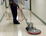 Floor buffing a municipal building floor