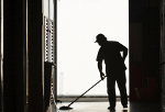 Worker cleaning-up at a sports complex